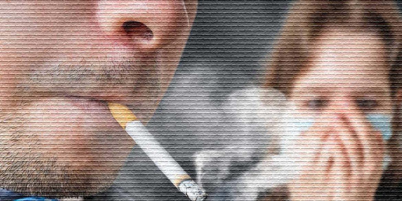 Сигарета во рту дымится